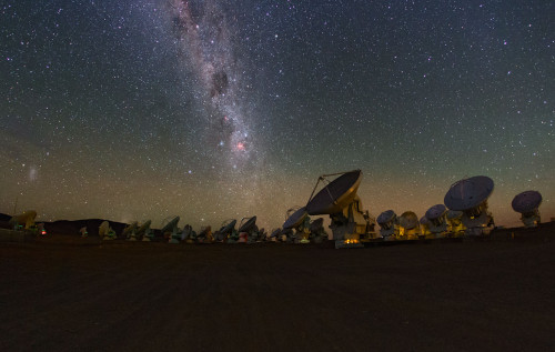 The Milky Way glitters above the ALMA array in this image taken from a time lapse sequence during the ESO Ultra HD Expedition.