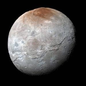 Charon med sin röda nordpol. Källa: NASA/JHUAPL/SwRI